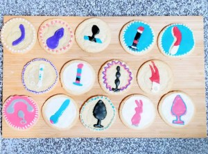 14 sex toy cookies on a cutting board