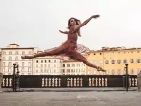 Photo of a dancer doing a split leap.
