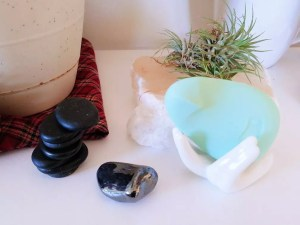 Dame Pom vibrator next to crystals and rocks