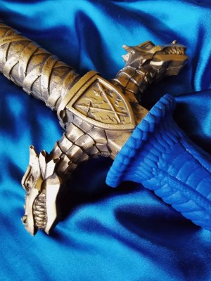 [Image: a close-up of the Drago sword dildo hilt and the dragons on either side.]