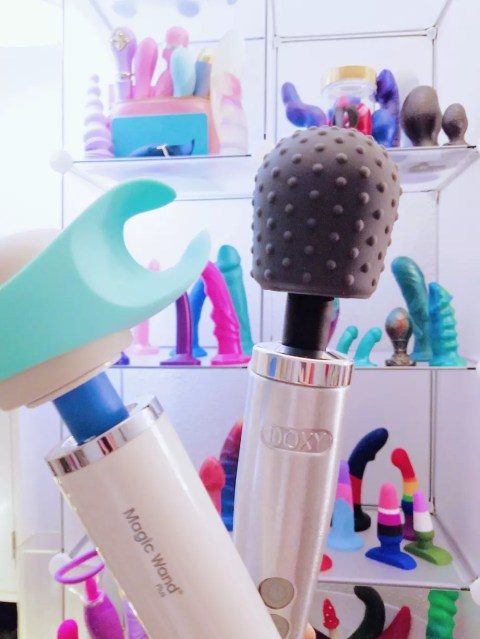 [Image: Magic Wand Plus with teal We-Vibe Wand Stroker attachment and silver Doxy Die Cast with grey dotted Le Wand texture cover]