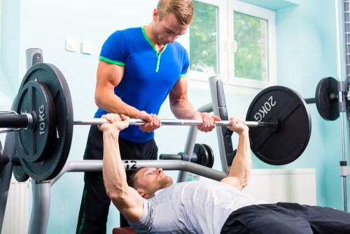 Spotting for Bench Press. Safety in the gym. Injury prevention.