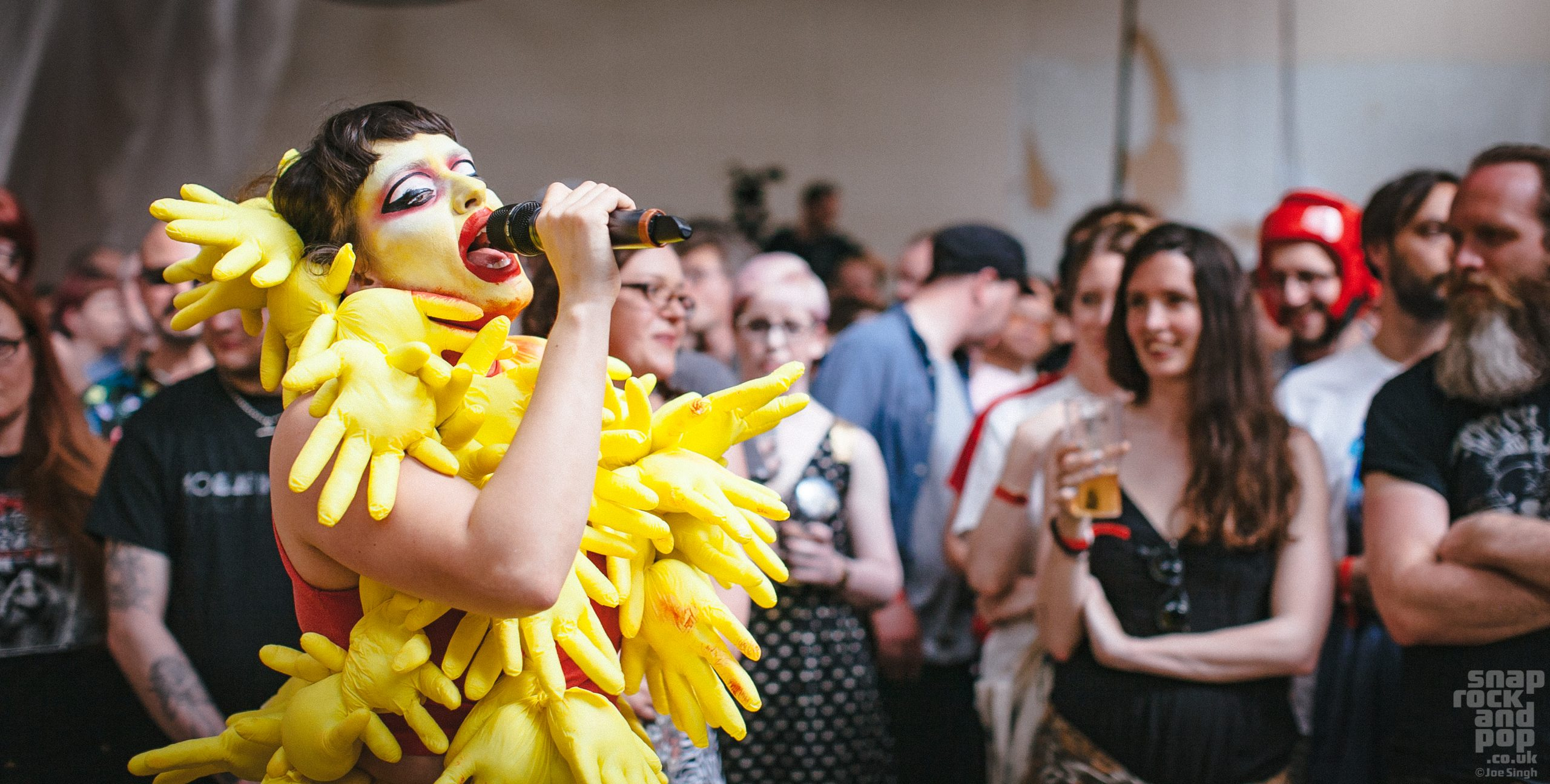 Natalie sharp aka. Lone Taxidermist performing at Supersonic Festival 2017 in a yellow costume