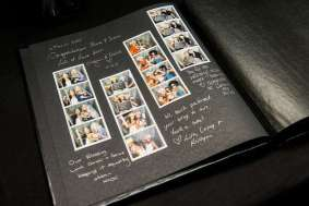 "Black Leather ""Ready to Mount"" photo-strip Album, complete with gold & silver pens. Our interpretation of the perfect guest-book! Every page has double sided tape attached for photo-strips"