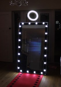 magic mirror photo booth with hollywood lights frame