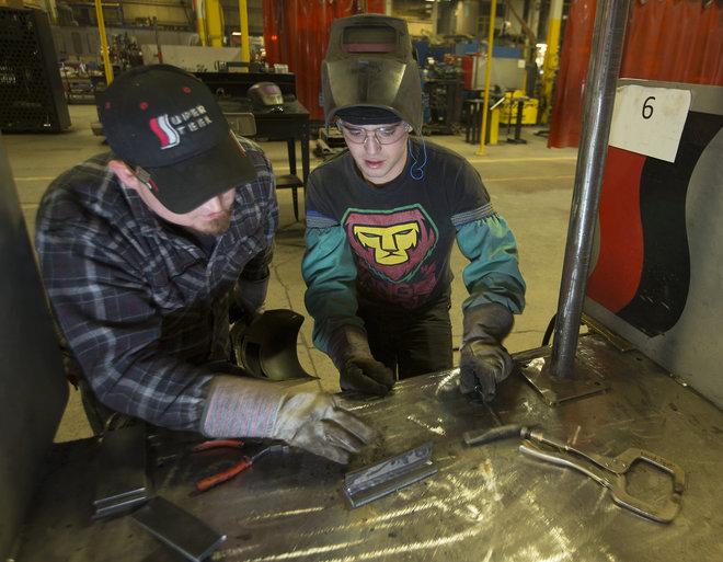 Super Steel welding trainer Pat Nowak (left), who has 13 years of experience, tutors recent hire Cody Kinnee. Photo by Mark Hoffman.