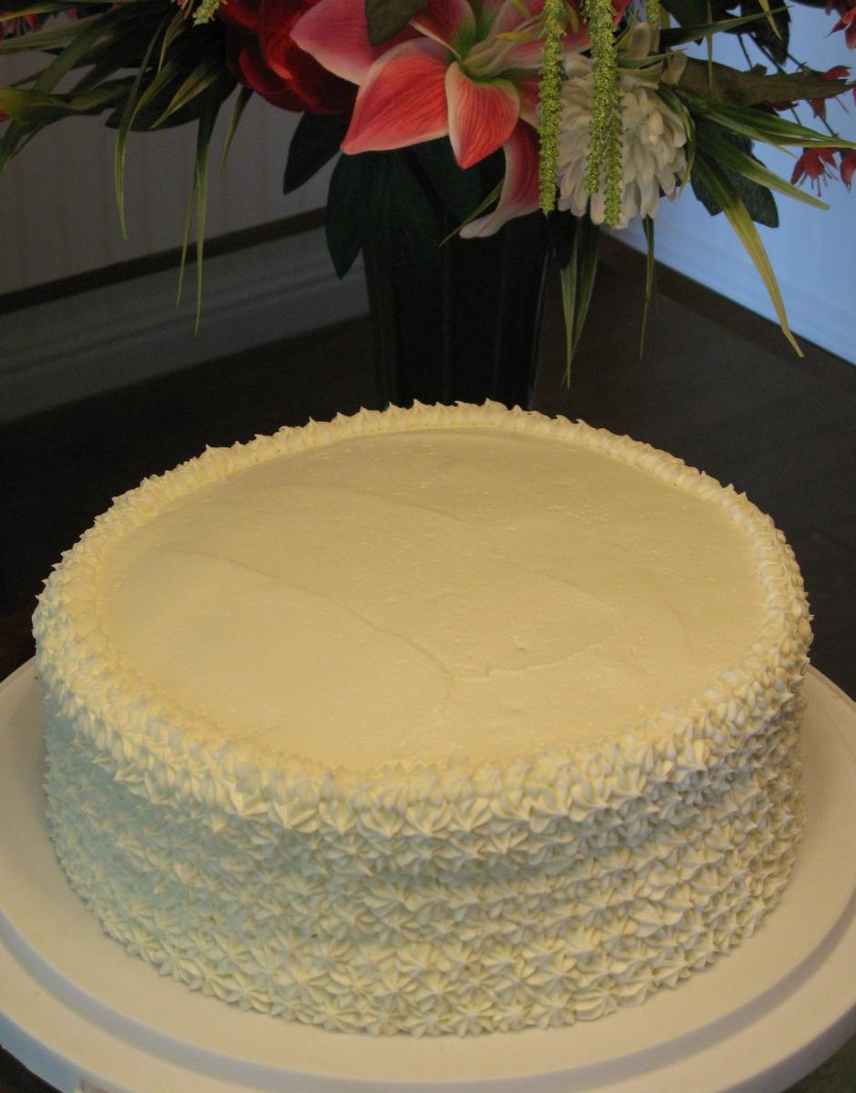 White Almond Cake with Bavarian Cream Filling and White Truffle Icing