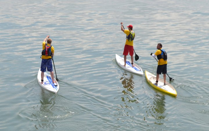 Iain McCarthy with students stand up paddleboarding in Bangor, Northern Ireland