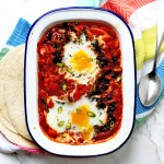 Spanish style Shakshuka with gooey egg yolks and flatbreads is made with green chillies and chorizo making it the perfect dish for breakfast,brunch, lunch or dinner.