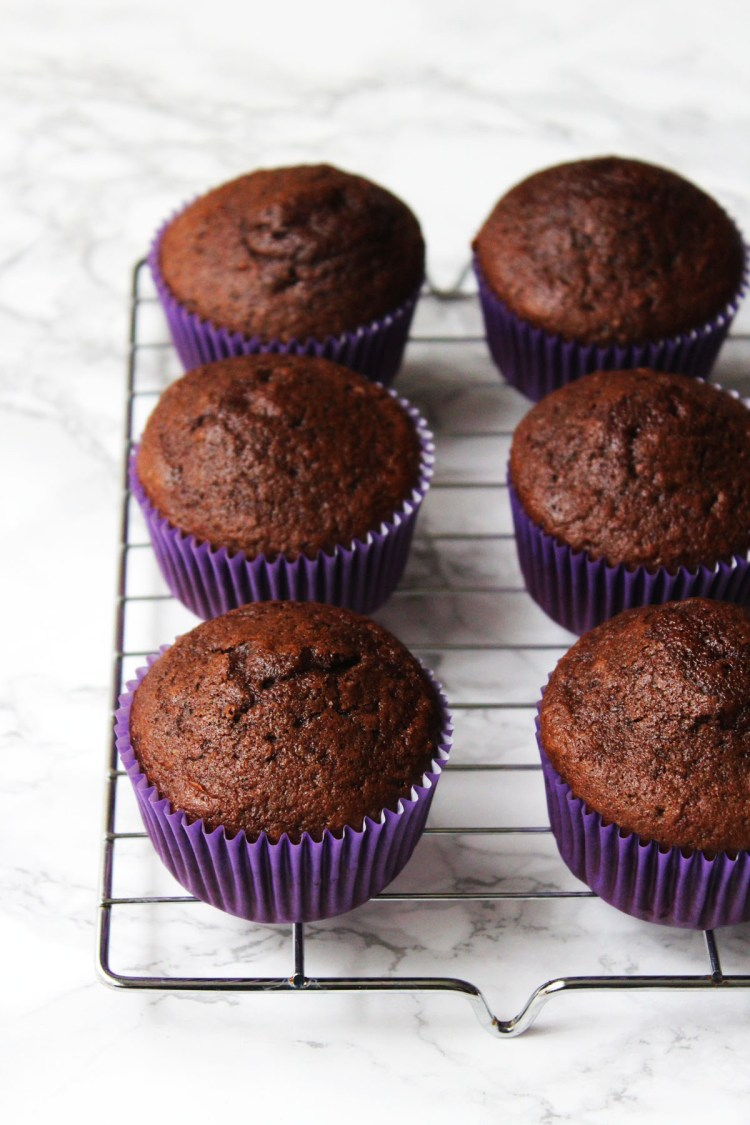 Check out this classic recipe for Dark Chocolate Cupcakes from Supper in the Suburbs topped with butter cream and passion fruit for a fun summer recipe