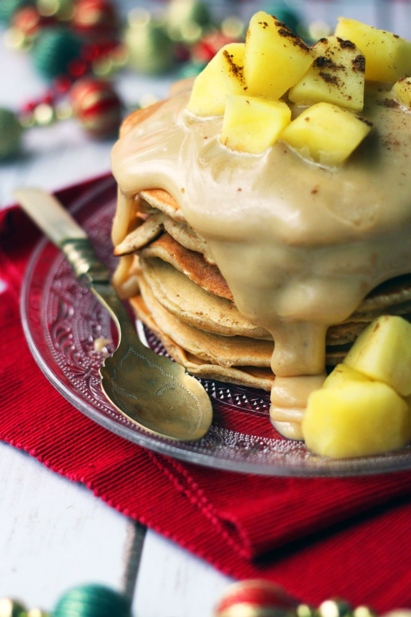 These cinnamon pancakes are dripping with caramel sauce and topped with stewed apples