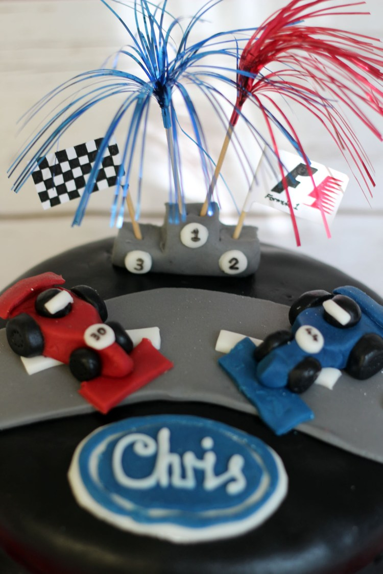 Racing Cars atop the Formula 1 Themed Cake from Supper in the Suburbs