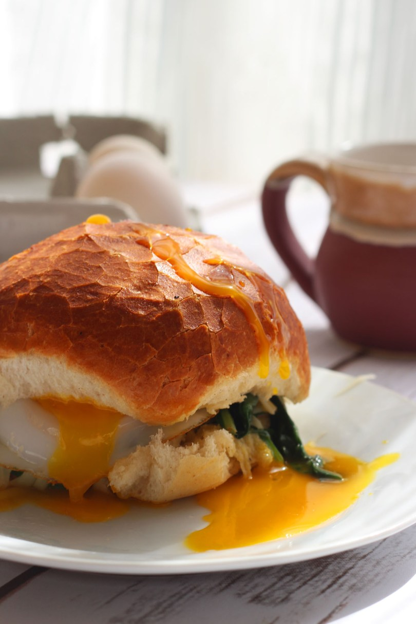 Duck egg sandwich with gruyere and spinach