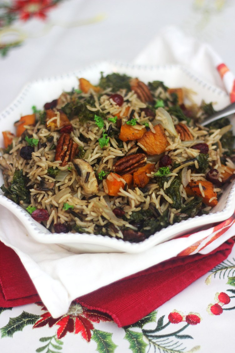 This Wild Rice Pilaf tastes of Christmas with cranberries pecans and winter spices its a real festive treat find the recipe at Supper in the Suburbs
