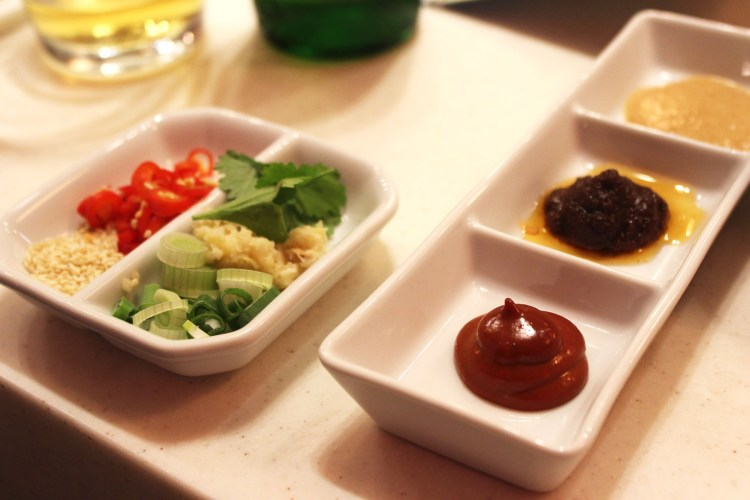 Don't underestimate the power of a good dipping sauce or garnish at Shuang Shuang