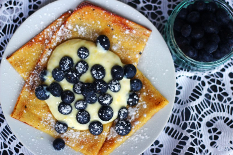 Nordic Oven Baked Pancakes from Supper in the Suburbs serve with yogurt and fresh blueberries
