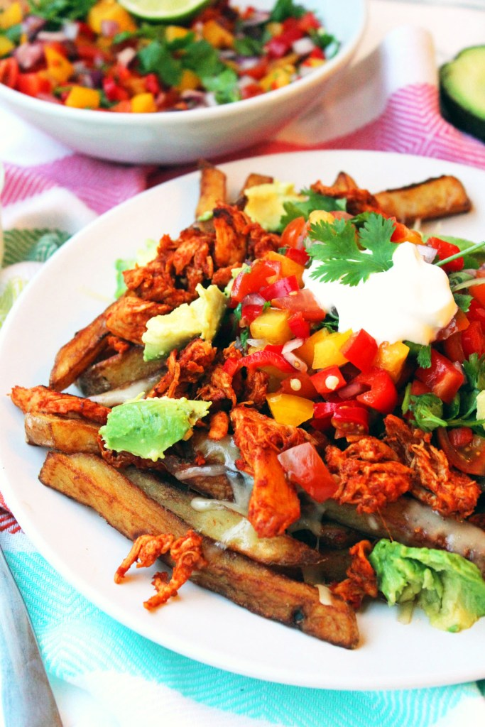 These Fully Loaded Nacho Fries have all the flavours of classic nachos with chilli, salsa, guacamole and sour cream, shredded spicy chicken and cheese but with chips instead of tortillas. This is one epic mid week meal, Saturday supper or sharing dish. Recipe at Supper in the Suburbs.