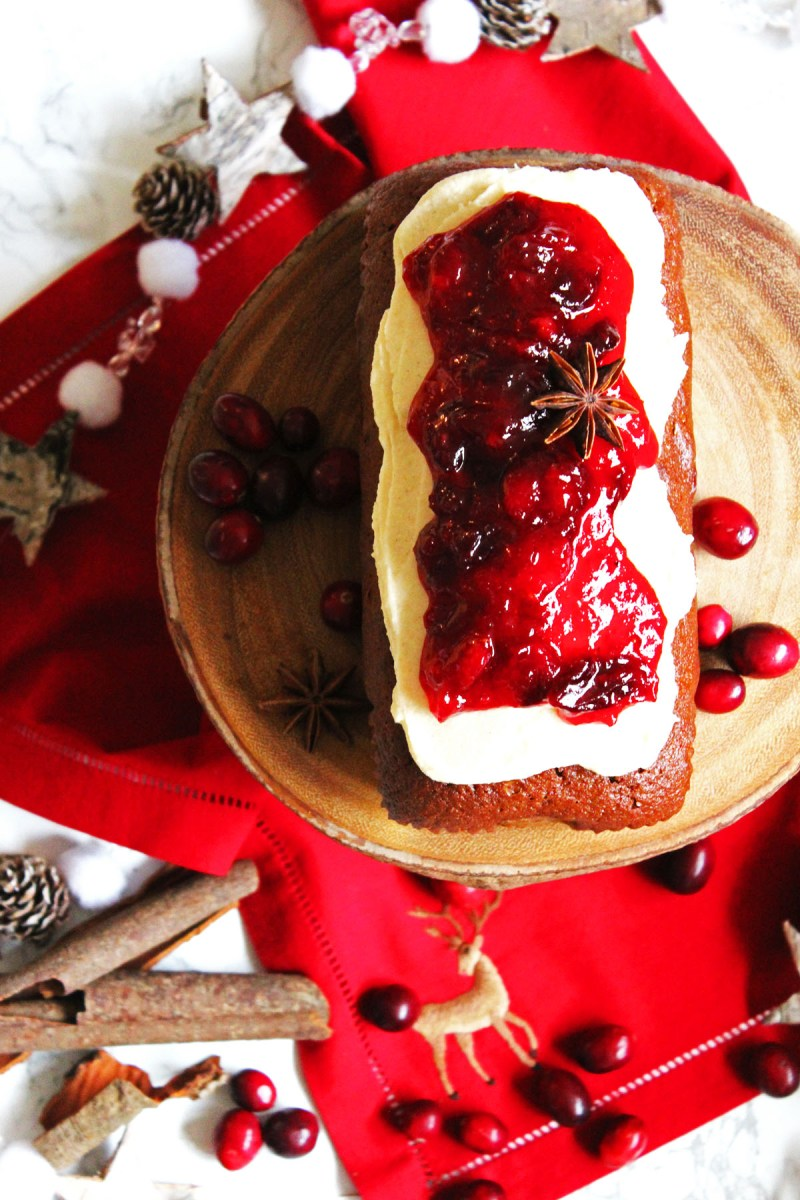 This Cinnamon Loaf Cake is topped with Cream Cheese Frosting and a Mulled Cranberry Compote. It's the perfect afternoon treat for the cold winter months. Why not serve with a hot cup of coffee on a frosty afternoon. Get the recipe for this simple loaf cake at Supper in the Suburbs