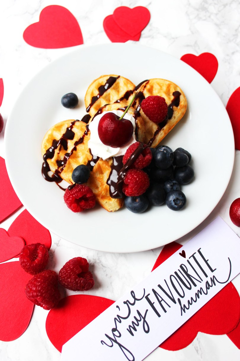 These heart shaped Vanilla Bean Waffles are the perfect Valentines Day breakfast or brunch! Top them with your favourite fruits, sauce and cream. You could even add sprinkles and nuts! Get the recipe on the blog.