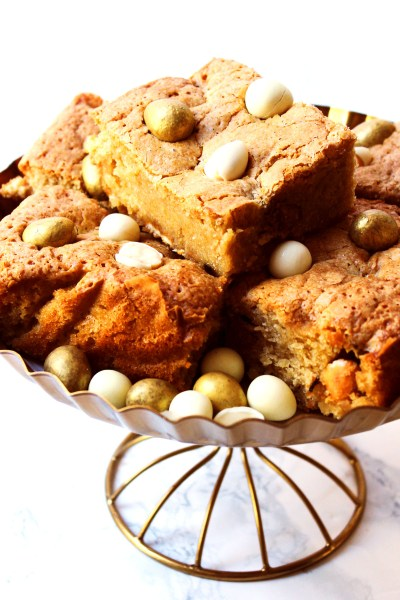 These Easter Blondies (aka White Chocolate Brownies) are the perfect Easter treat! Made with Galaxy's Golden Eggs and Milky Bar White Chocolate Mini Eggs. Get the recipe at Supper in the Suburbs!