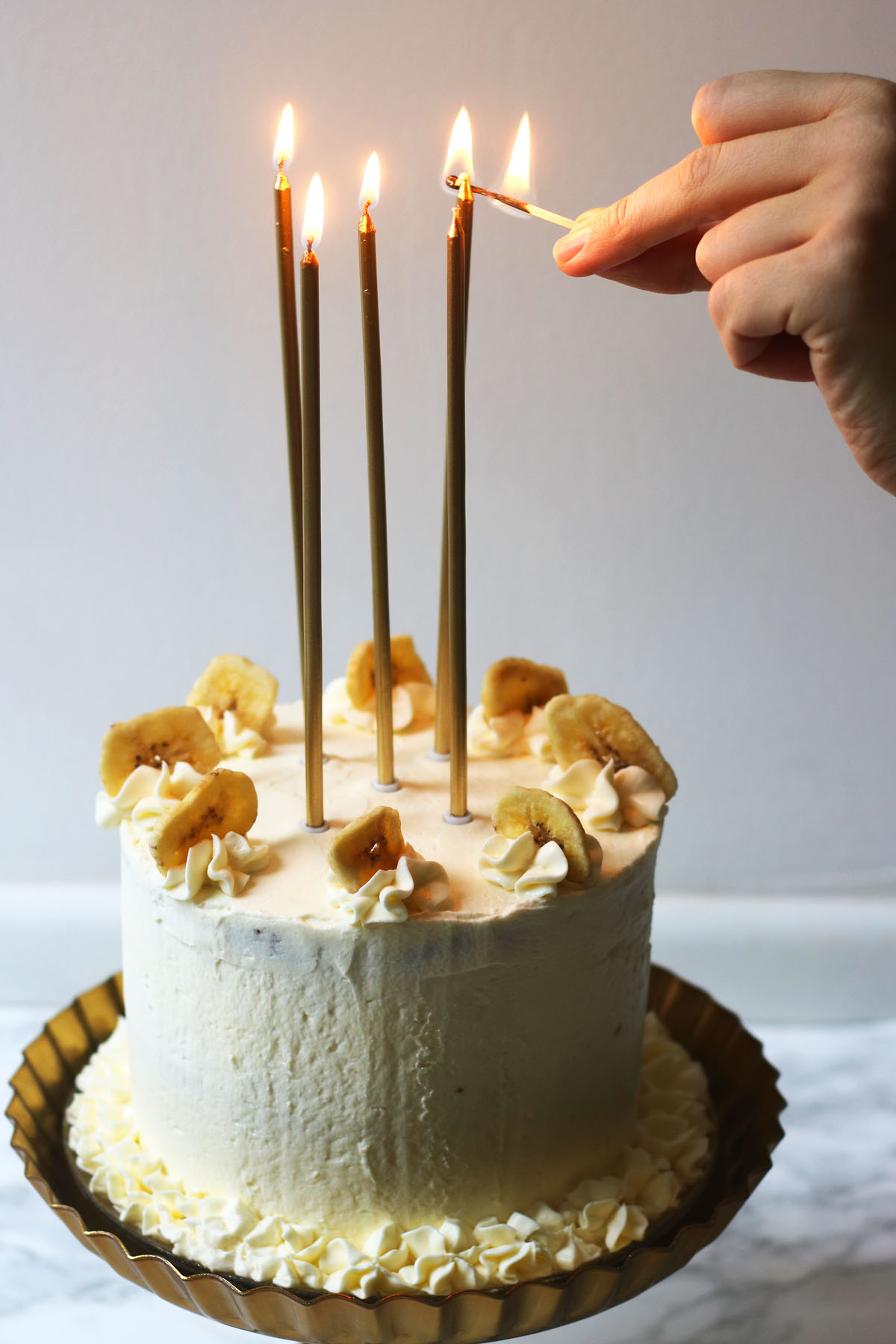 Lighting the candles on my Banana Cream Cake for my birthday