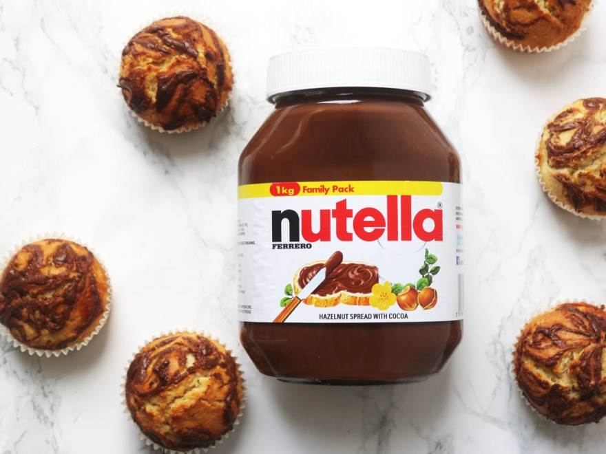 These Nutella Stuffed Muffins are the perfect way to celebrate Wolrd Nutella Day. Get the recipe at Supper in the Suburbs!