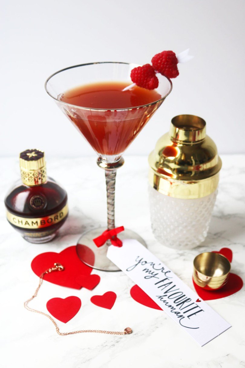 This twist on a French Martini swaps vodka for gin and vermouth. Garnished with fresh raspberries this Chambord cocktail is perfect for Valentines Day!