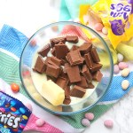 A microwave proof bowl with chocolate, butter and condensed milk