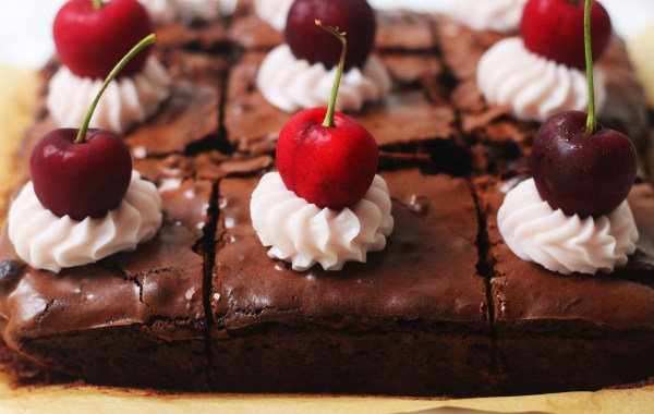 A tray of cherry and pecan brownies