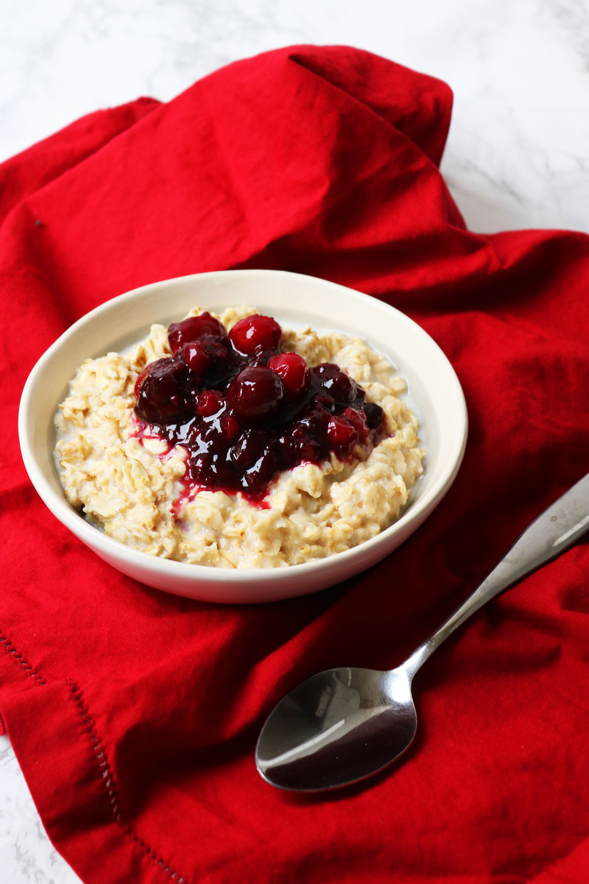 Small bowl of spiced berry porridge