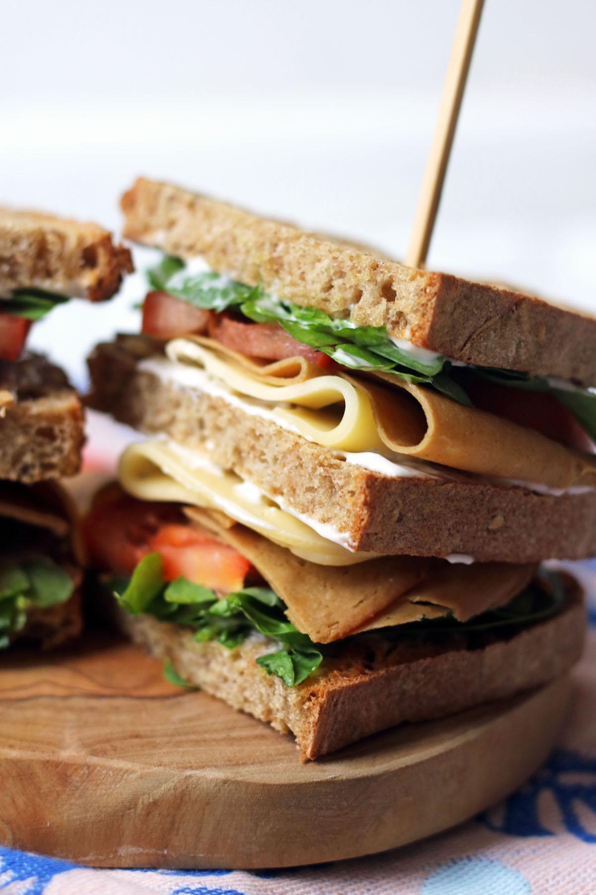 Half of a vegan club sandwich