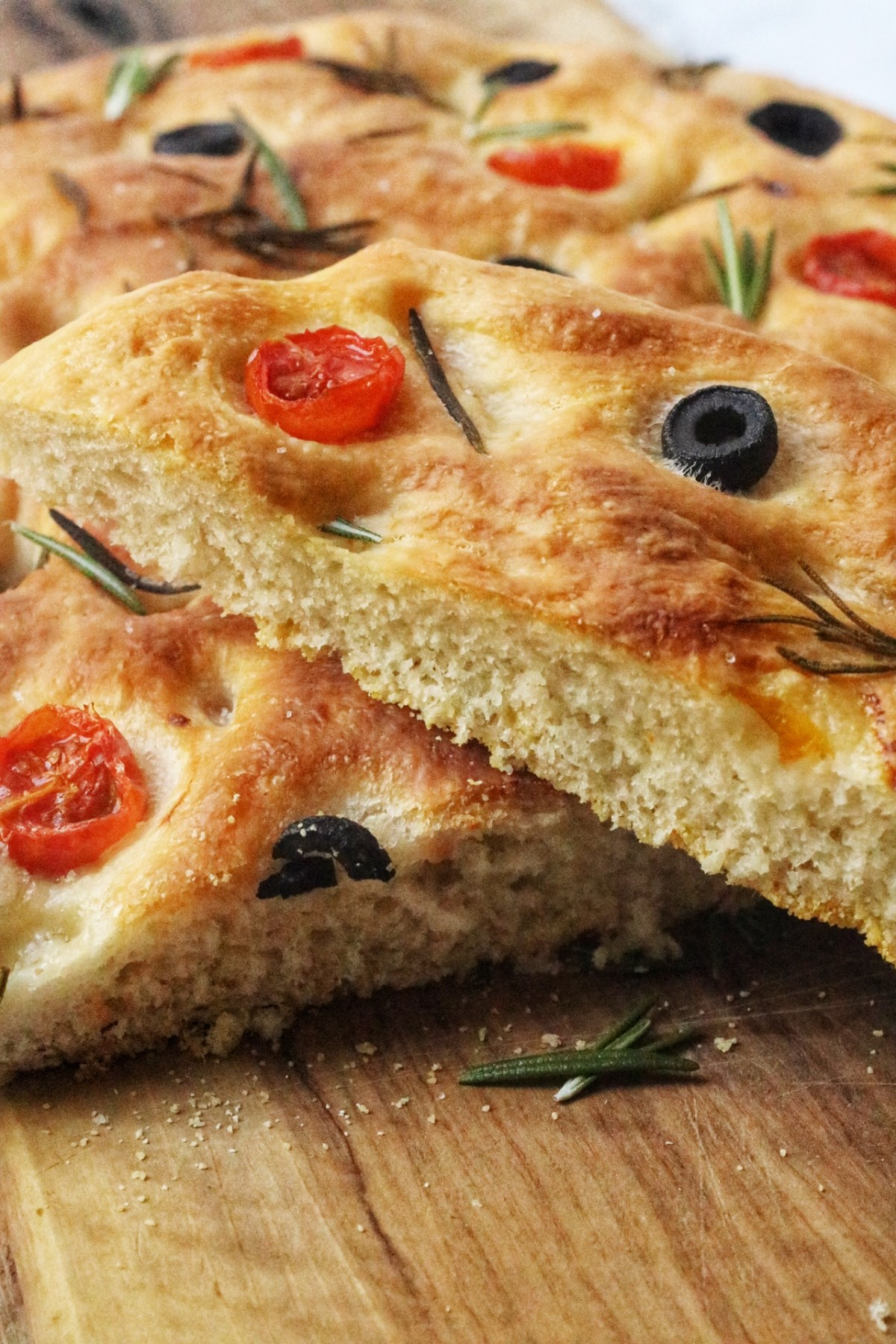 This classic focaccia recipe is flavoured with salty black olives, sweet cherry tomatoes and earthy rosemary