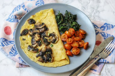 Savoury Vegan Crêpe topped with mushrooms, spinach and tomatoes