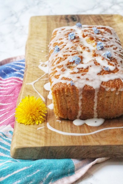 Vegan Lemon Drizzle Cake topped with flowers