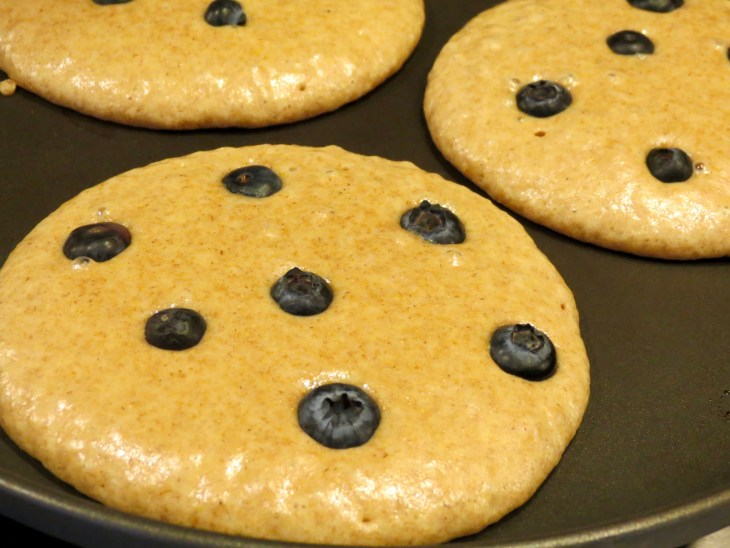 Blueberry Whole Wheat Pancakes Just Before Flipping