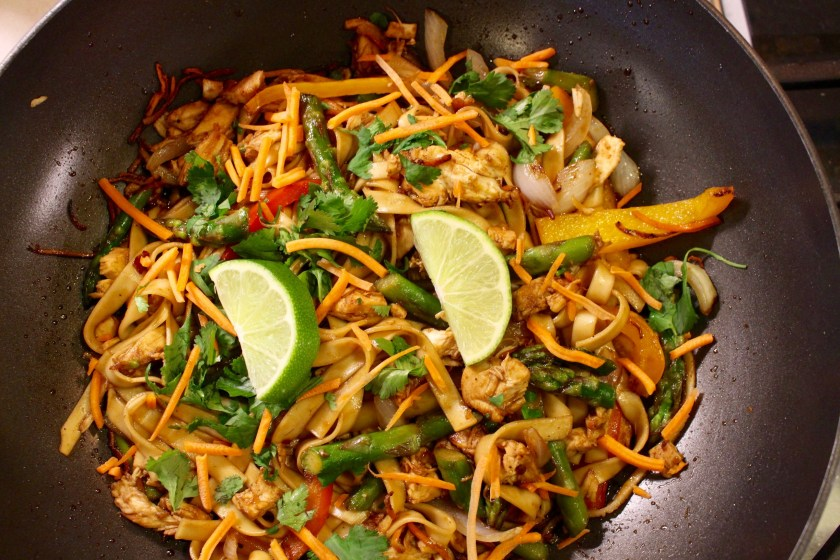 Easy Chicken Stir Fry with Noodles In Wok with lime slices