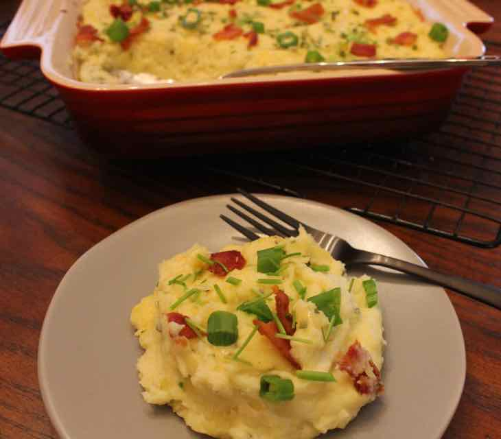 Loaded Twice Baked Potato Casserole Serving on a green plate with a fork