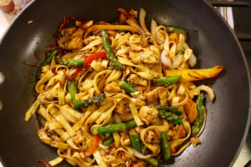 Stir Fry in Wok with Veggies and Chicken and Sauce