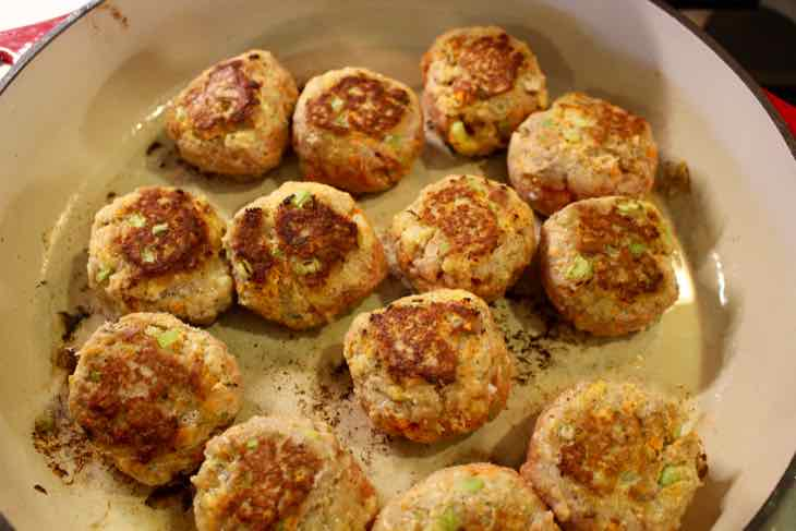 Buffalo Turkey Meatballs browned in a skillet