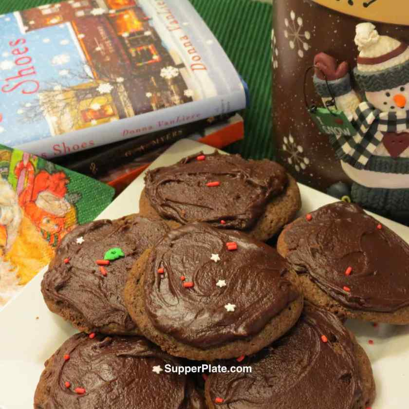 Soft Chocolate Drop Cookies plated surrounded by books and a snowman cookie container