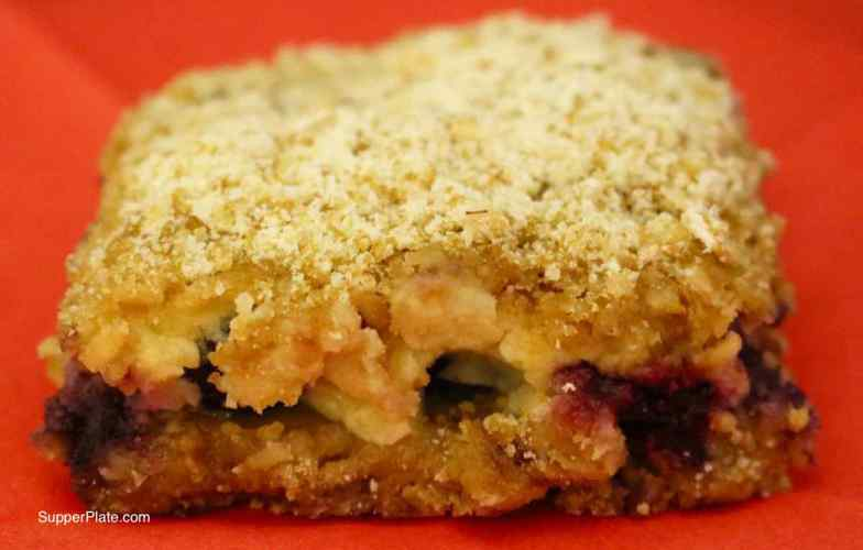 Blueberry Bars with Lemon Cream Filling - closeup of single bar