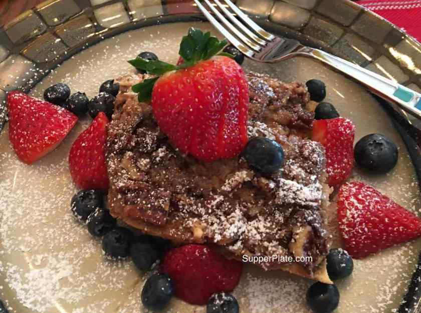 Cinnamon French Toast Bake Plated with berries and a fork