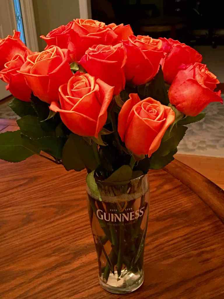 Flowers in Guinness Glass