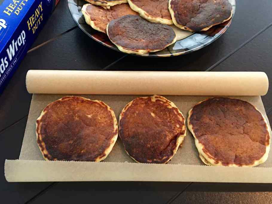 Three pancakes on parchment paper for freezing