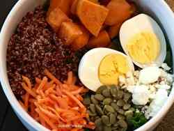 Top view of Kale Sweet Potato Salad in a white bowl