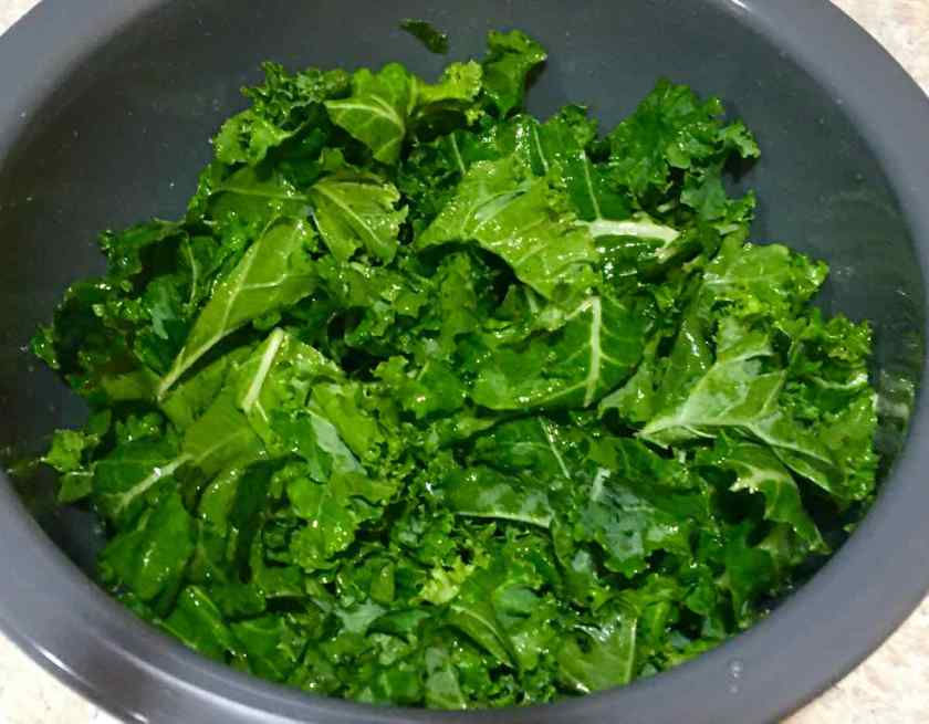 Kale with oil and vinegar in a bowl
