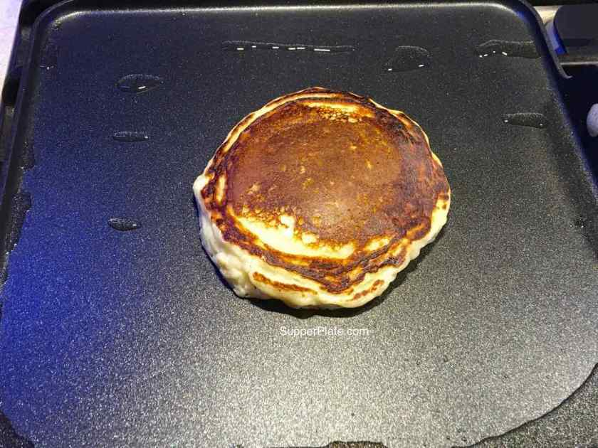 First pancakes on the griddle