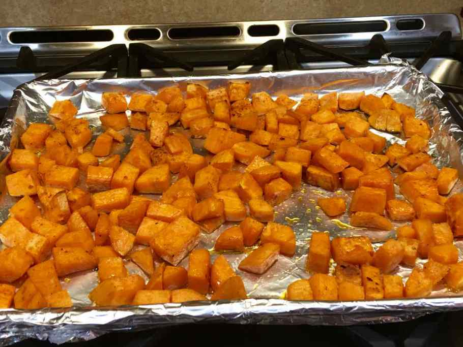 Sweet Potatoes out of the oven on a baking pan