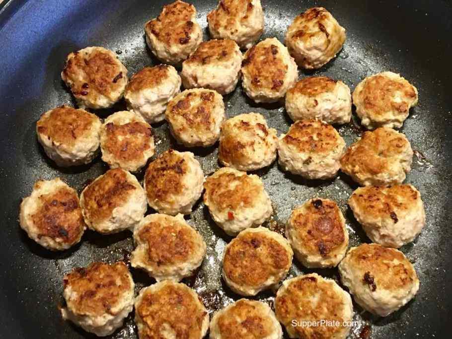 Browned meatballs in a frying pan