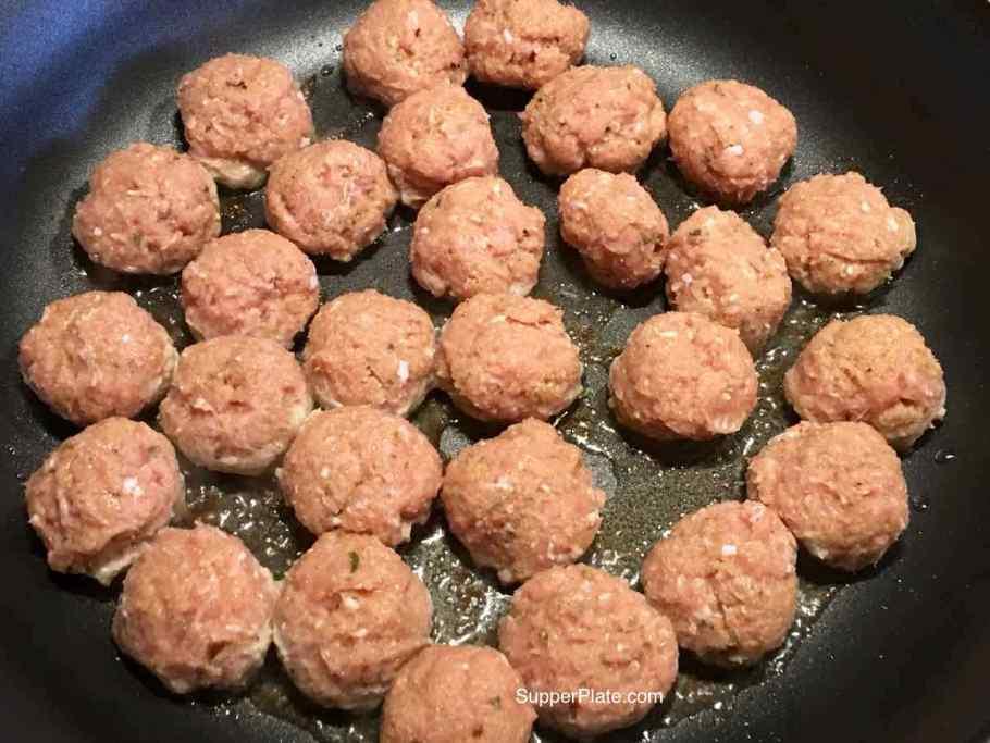 Mini meatballs in a frying pan